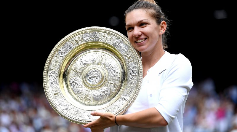Simona Halep celebrates with the trophy after winning the women's singles final