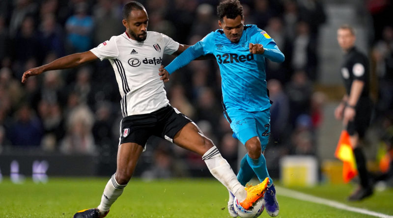 Fulham's Denis Odoi (left) and Derby County's Duane Holmes battle for the ball