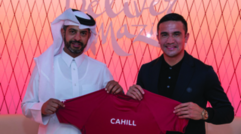 Tim Cahill with Nasser Al-Khater Deputy Secretary of Qatar's Supreme Committee