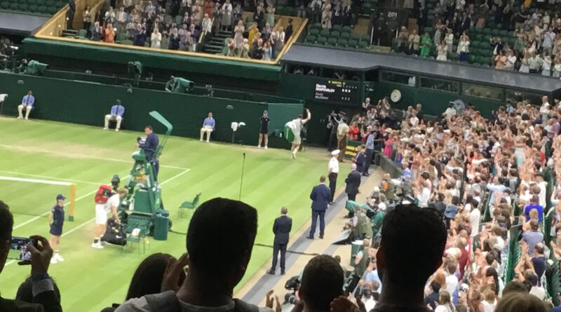 Andy Murray and Denis Shapovalov on Centre Court at Wimbledon