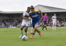 Dons boss Robinson: Playing against Arsenal on Wednesday was not on our players' minds